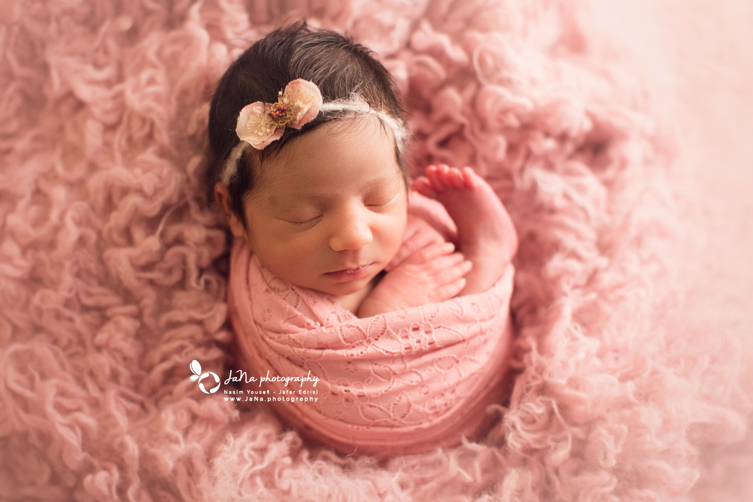 newborn baby girl in a pink fur | jana photography North Vancouver