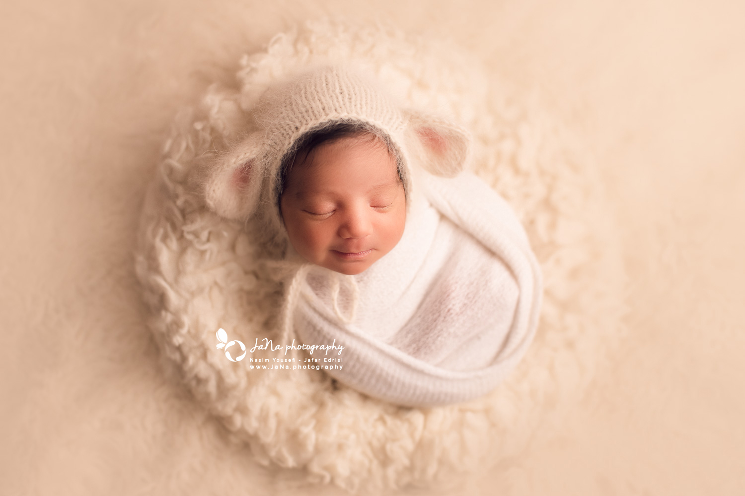 newborn baby girl with cute sheep hat - white fur