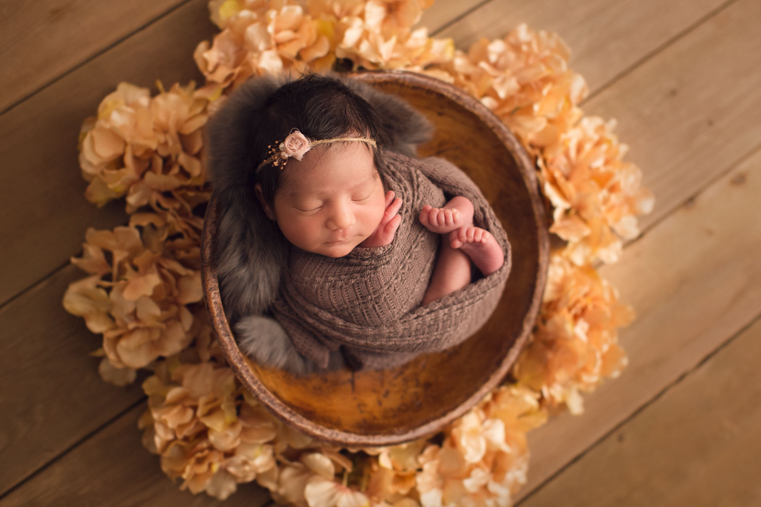newborn photography - North Vancouver - in a brown basket full of flower