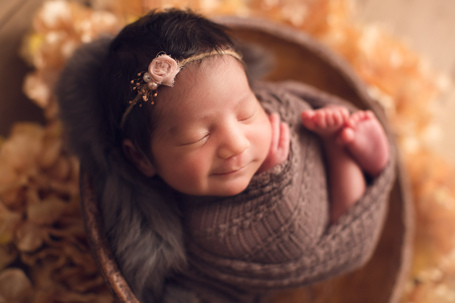baby girl in a brown basket - smile | jana photography