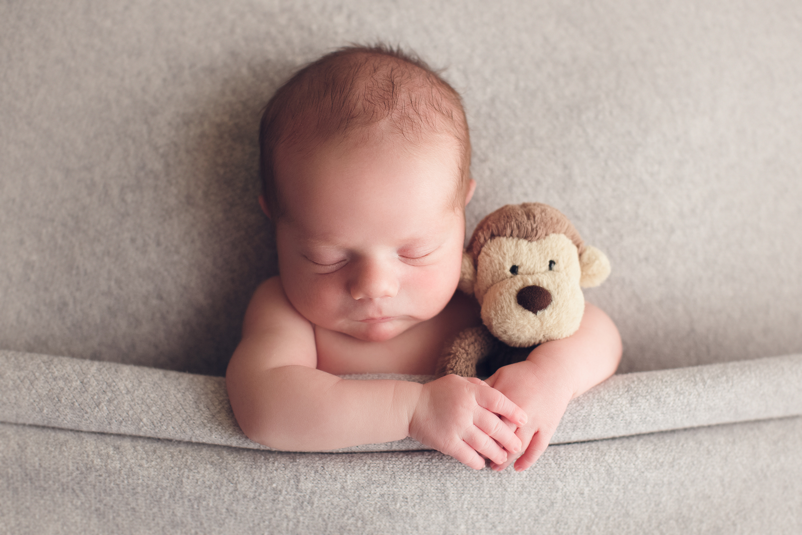 vancouver burnaby newborn photography - luca - with monkey
