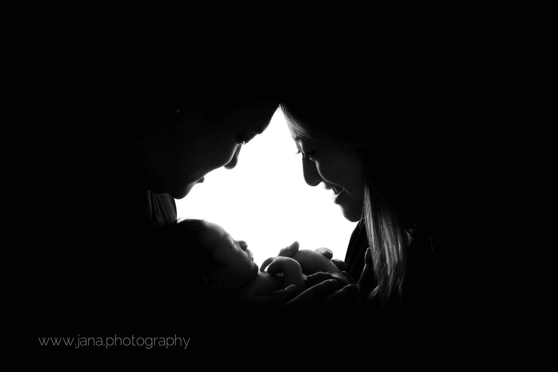 Newborn photography - mom and dad - black and white