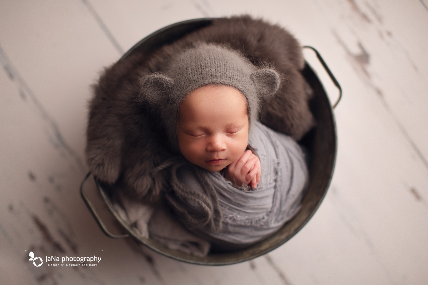 gray setup for newborn and bear hat