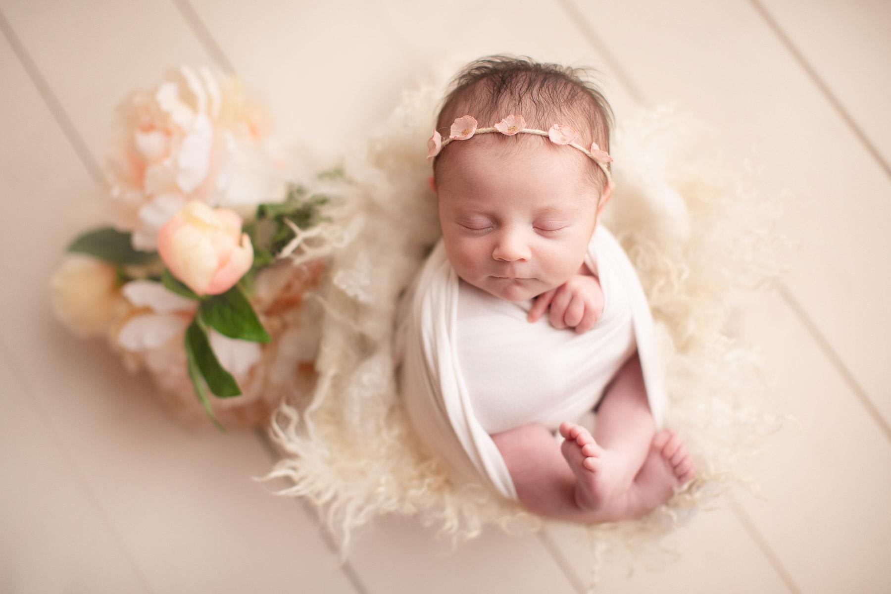 newborn girl- white setup whit flowers