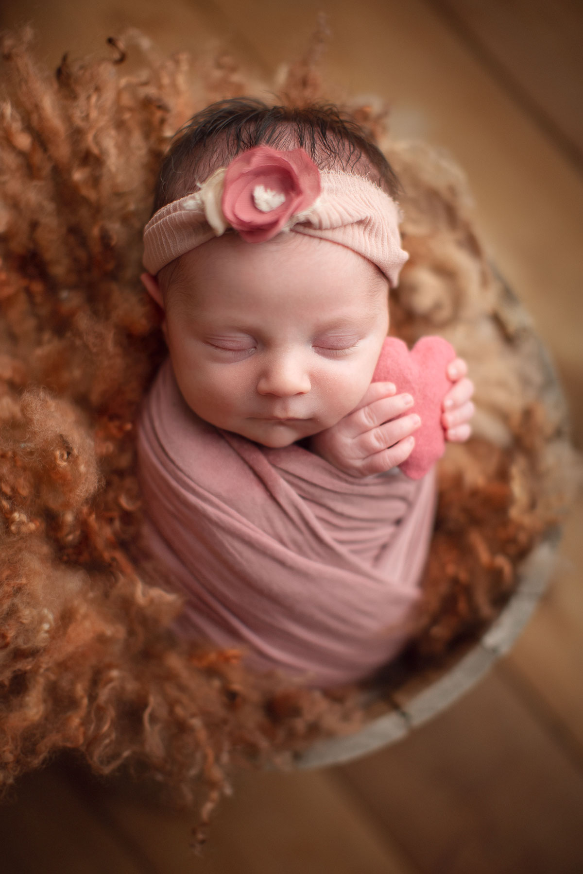 affordable vancouver newborn photography - baby girl holding heart