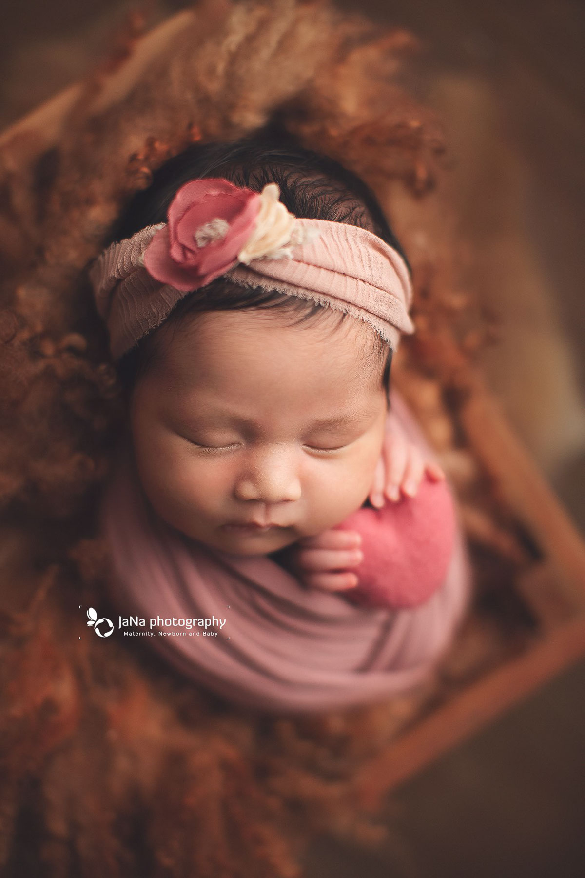 baby girl holding pink heart-jana- photography