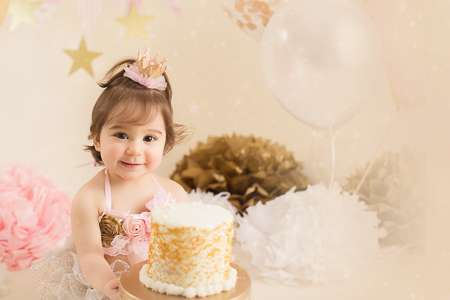 cute happy girl is going smash her birthday cake