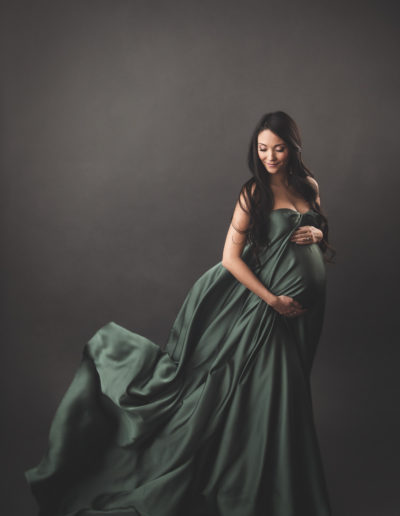 maternity photography green fabric gown