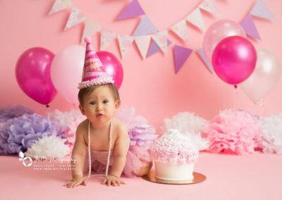 pink setup fore a baby girl cake smash | jana photography Vancouver