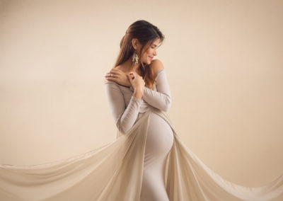 the best pose for maternity shoot with long with a long tail design, sexy yet elegant