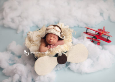 newborn baby boy - pilot - blue background - cloud