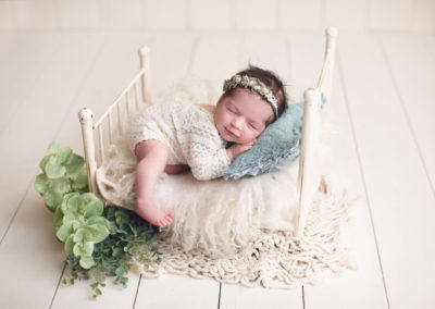 baby girl sleep in a white bed | jana newborn photography