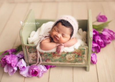 newborn-baby-girl-green-bed-tulip