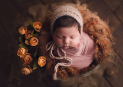 cute baby girl in a brown setup flower | jana newborn photography