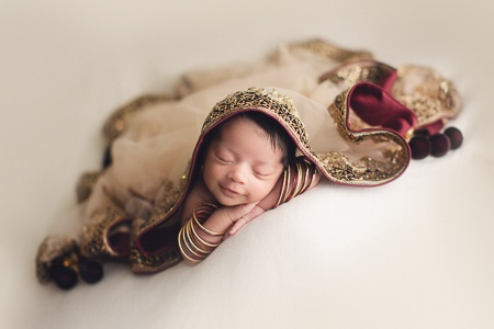 newborn baby girl with her mom's indian saree  | jana photography