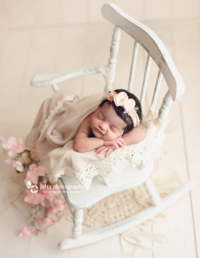 newborn-baby-girl-posing-chair