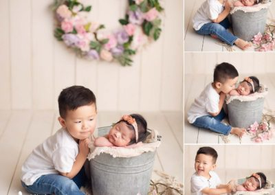 newborn-baby-girl-sibling-flower-nest