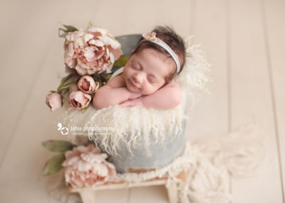 newborn-baby-girl-smile-flower-bucket