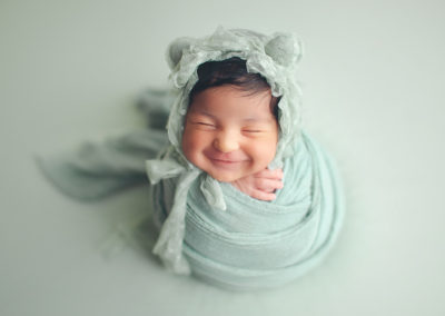 newborn-baby-girl-smile-green-jana-photography-vancouver