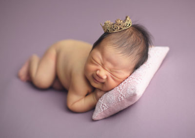 baby girl smile with gold crown | jana newborn photography