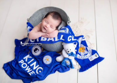newborn photography baby boy with Leicester City F.C. outfit