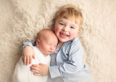 sibling brother hug newborn baby boy | Jana photography |Vancouver BC