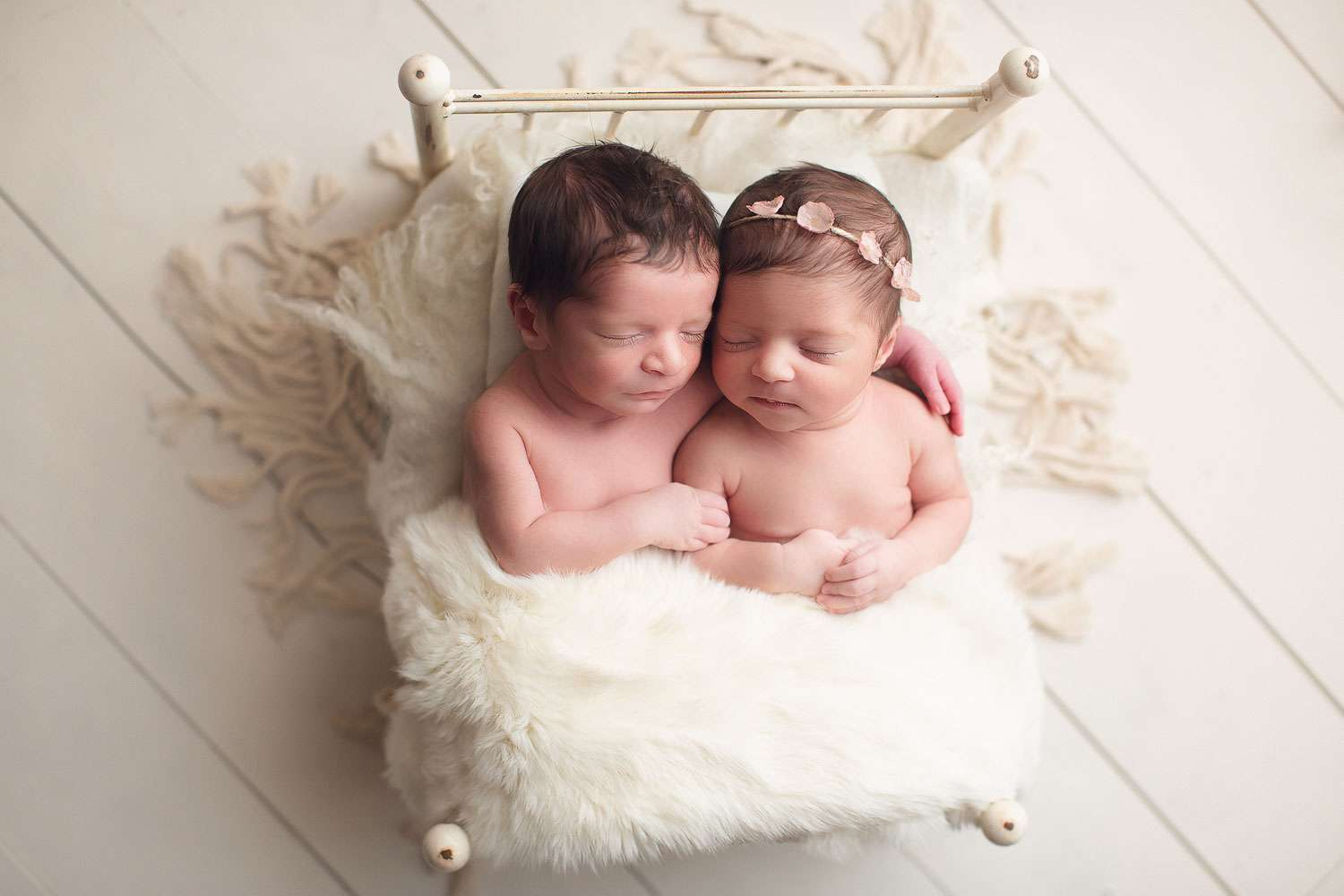 twins newborn siblings boy and girl sleeping in a white bed | Jana photography | vancouver