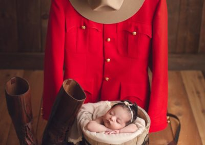 newborn photography baby girl with her dad mounted police outfit vancouver - rcmp