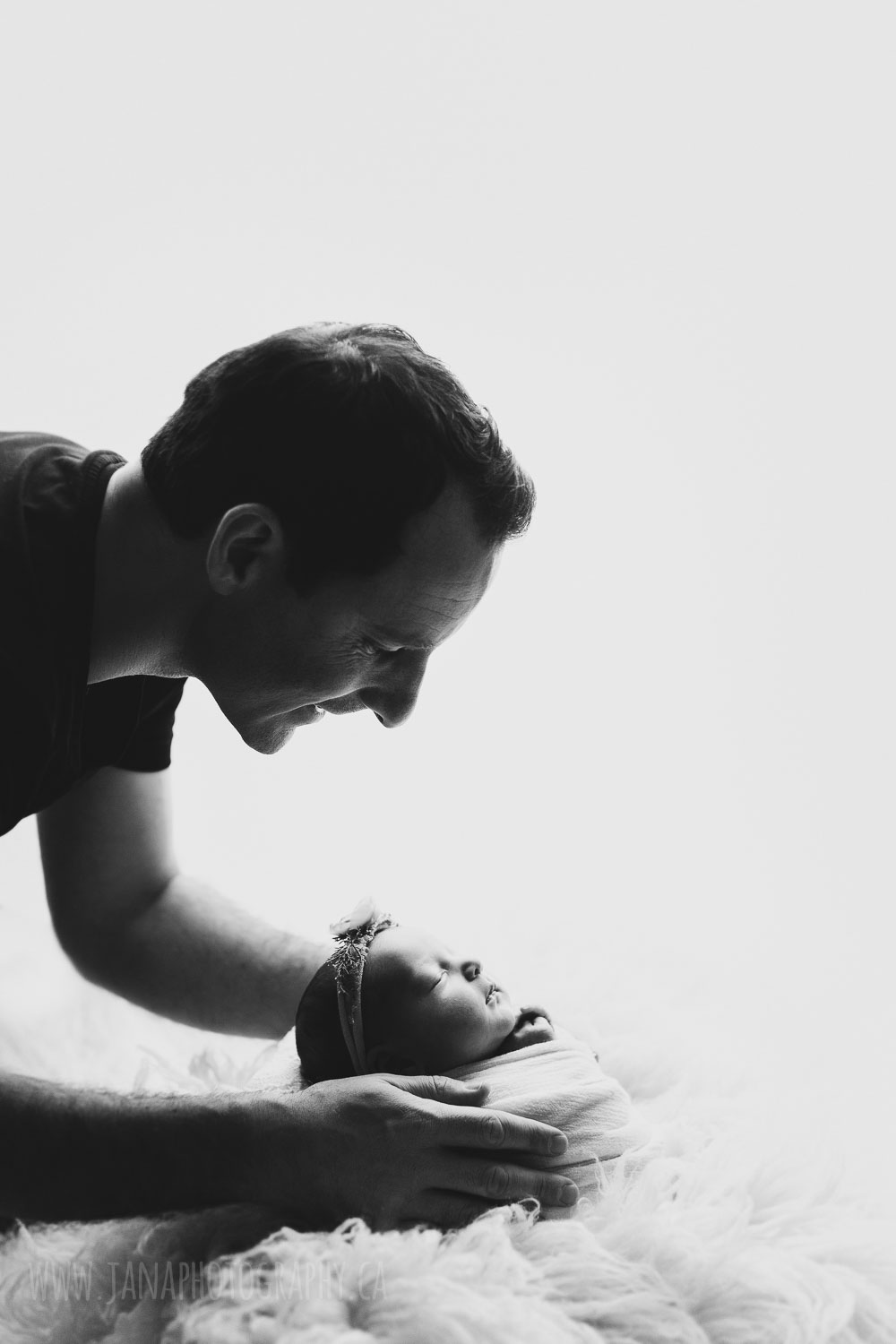newborn photography baby girl with dad - black and white