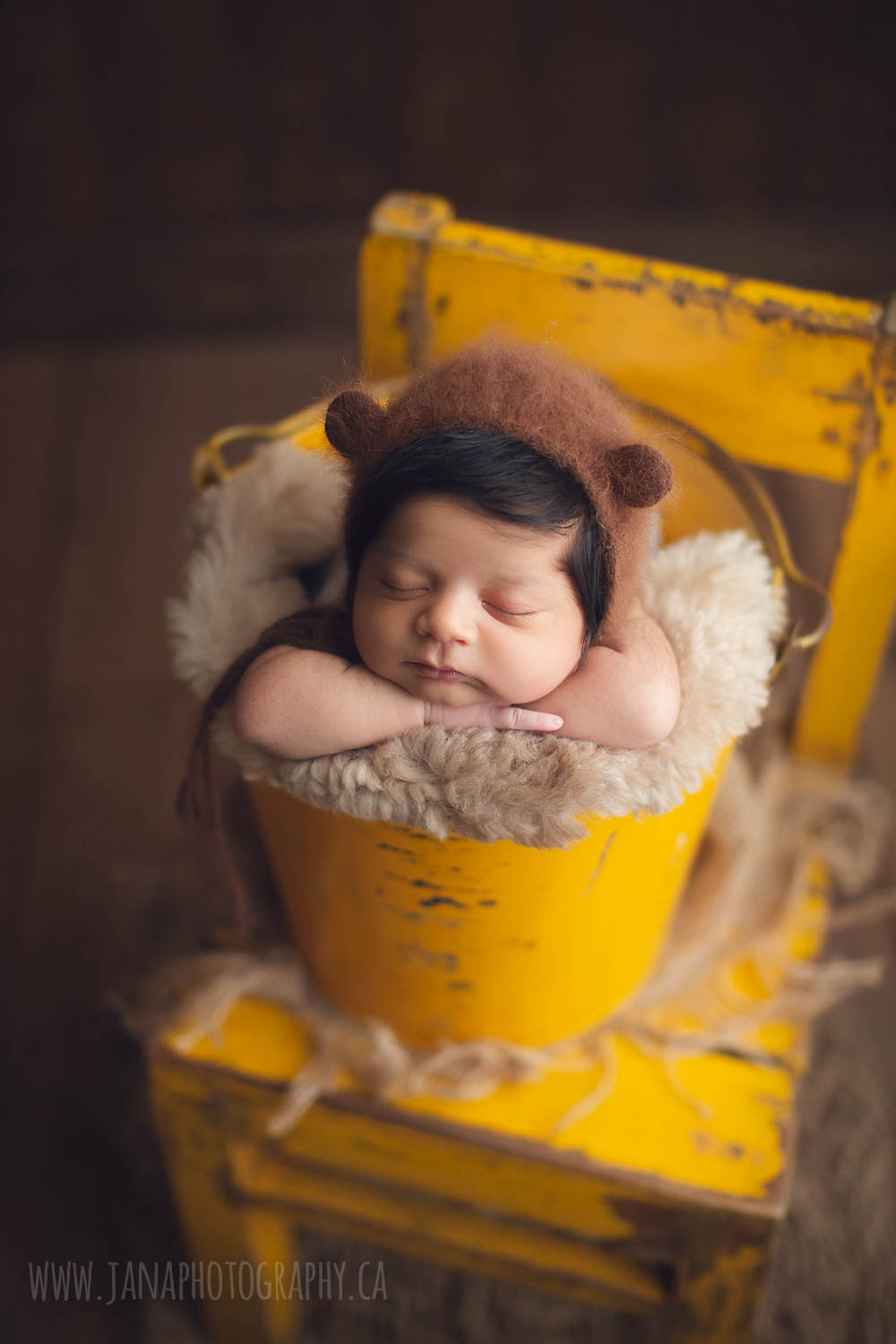 newborn baby boy - yellow bucket - bear hat