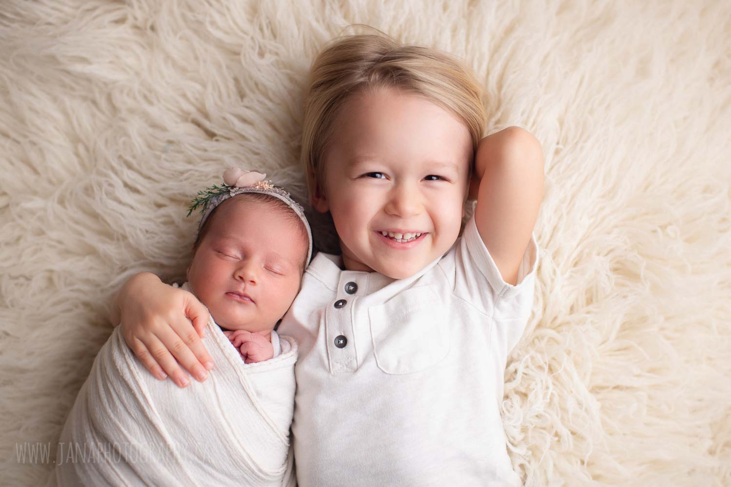 newborn photography with siblings - sister and brother - white setup