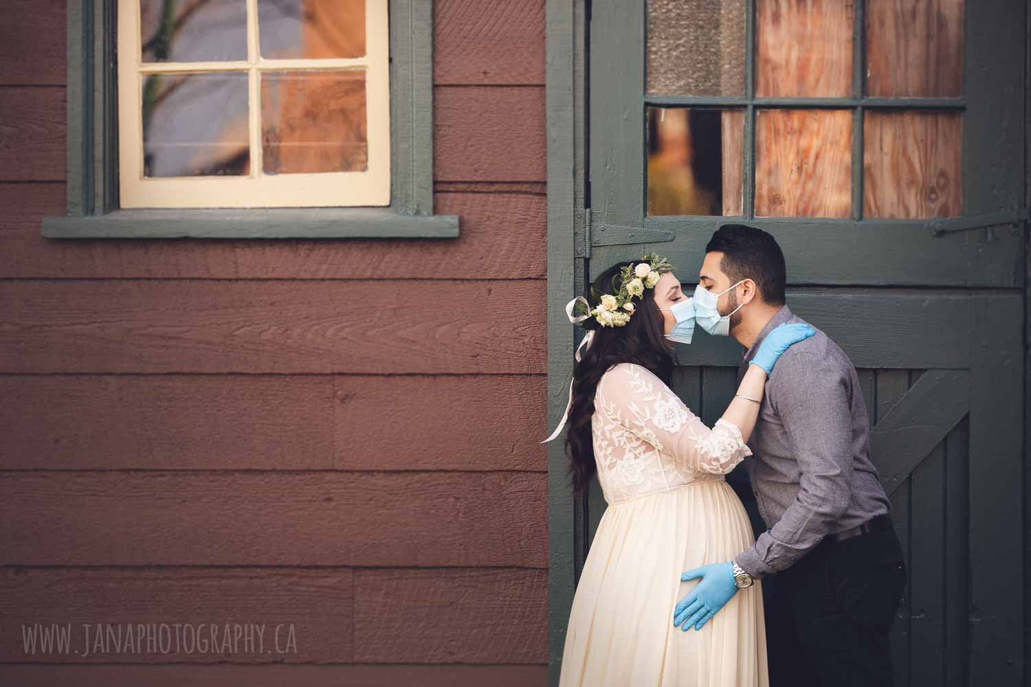 maternity photography outdoor during covid 19 - couple wearing face mask