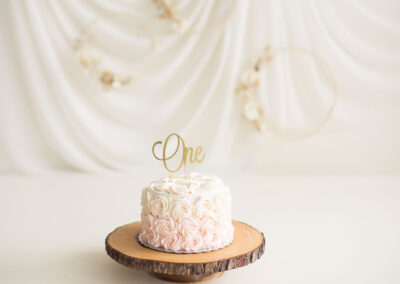 simple and timeless pink and white cake setup for girls