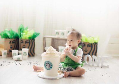 Starbucks theme cake smash with latte cake in white background
