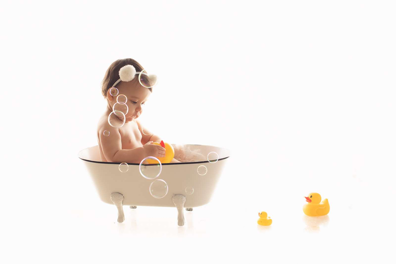 girl in the bubble bath with ducks