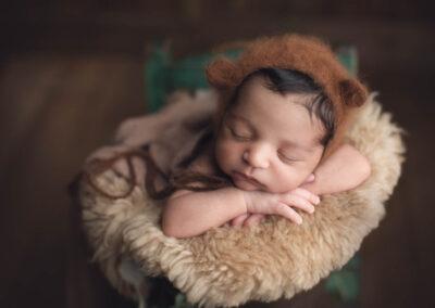 newborn boy in the brown bucket