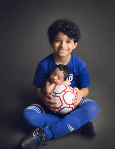new ideas for newborn photography with soccer ball